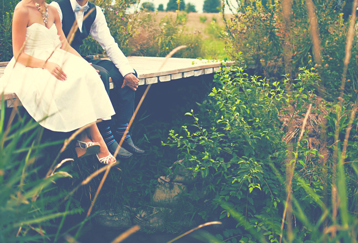Couple on Romantic Bridge After Wedding