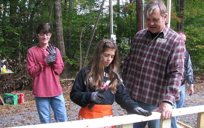 Gibbs family participates in Harley House build.