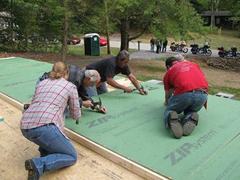 Volunteers building Smoky Mountain Harley House walls.